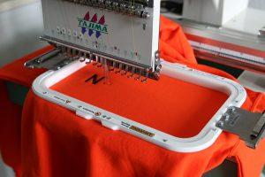 Embroidery machine branding a logo
