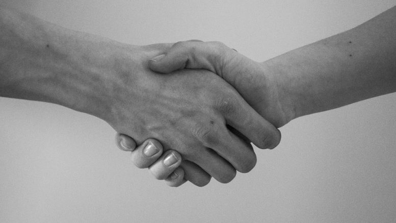 Two people shaking hands after choosing a Contract Manufacturing Partner